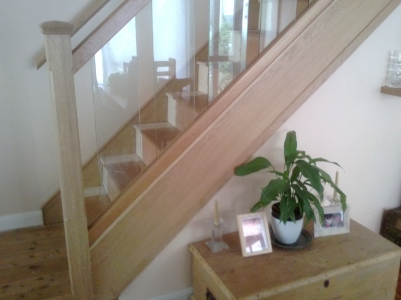 200mm glass panels to stair with oak stop chamfered newels and pyramid caps