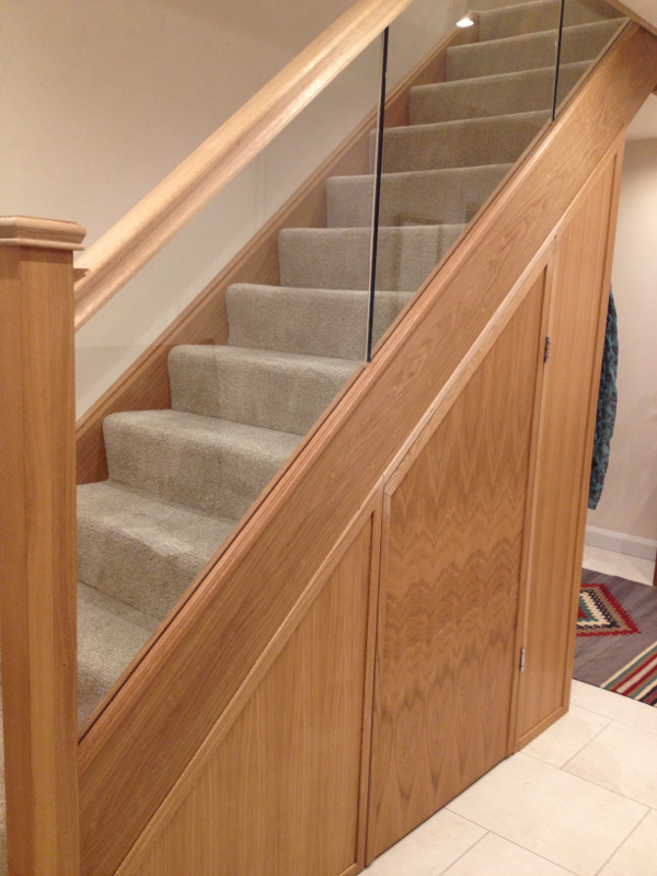 Traditional oak handrail with large CNC cut glass panels