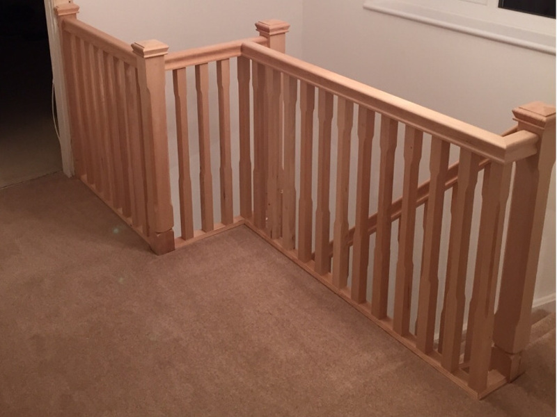 Hemlock stop chamfered newel posts with pyramid caps, traditional handrail and 41mm stop chamfered spindles